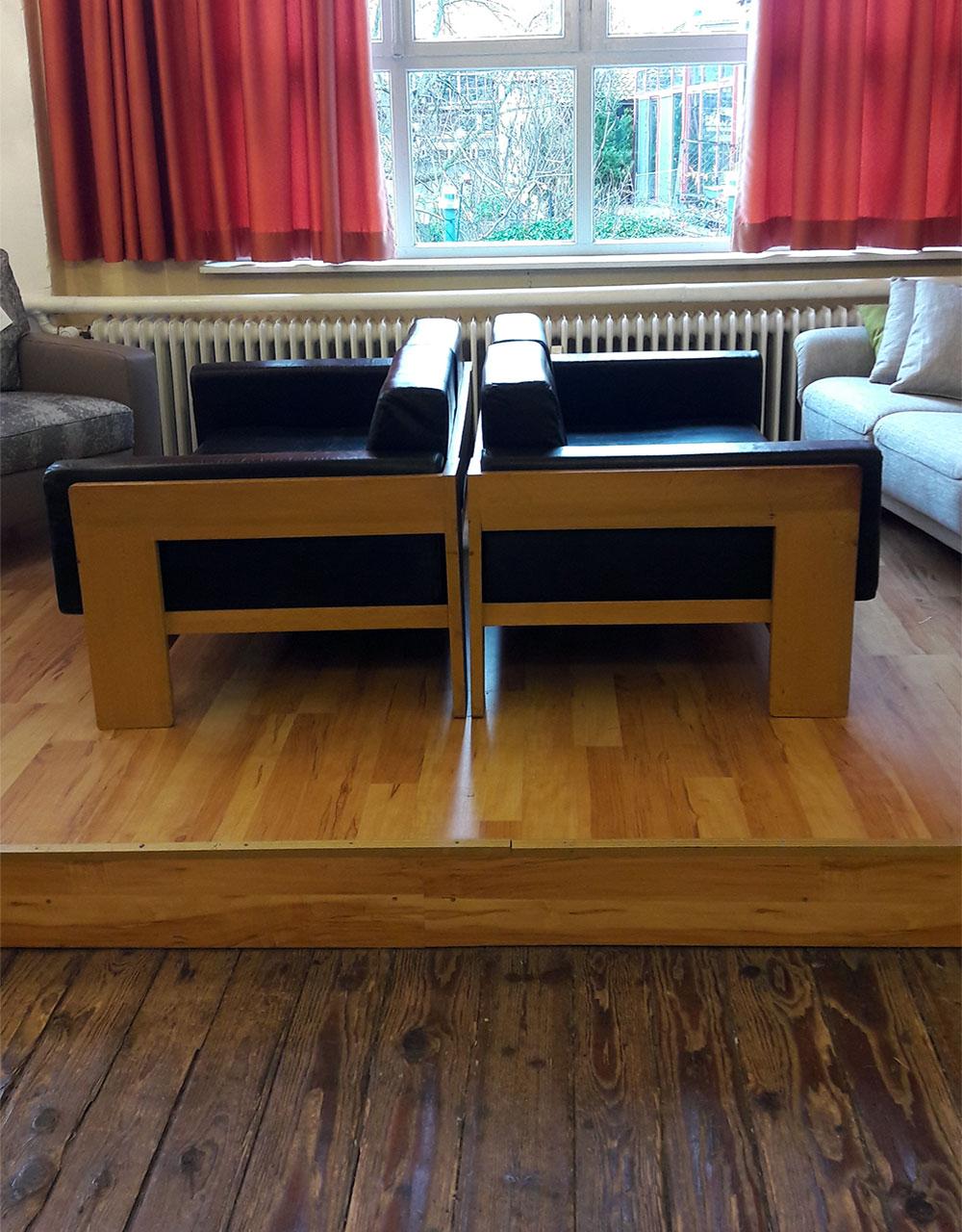 Restaurierung Sessel schwarz - Raumausstattung Wallner